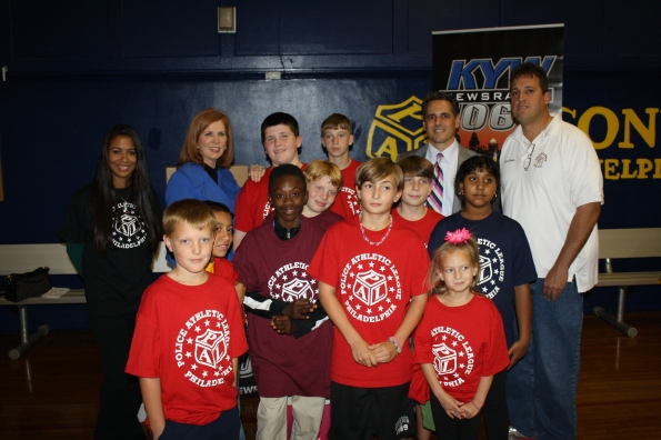 P/O Schneider and Tacony PAL youngsters with Kathleen Sullivan from Comcast and David Yadgaroff from KYW Newsradio