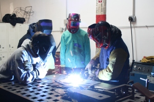 Audenried PAL members learning to weld with Bevan Weissman at Philadelphia Sculpture Gym