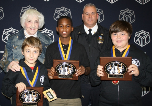 First, second and third place winners from 12-and-Under Division with Dr. Jacobi and Lt. Eddis