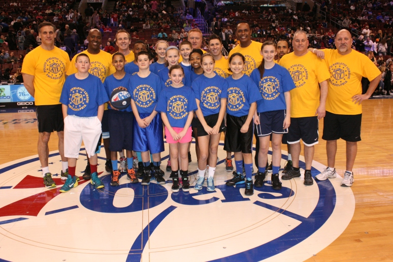 Gibbons PAL youngsters pose for a picture with PAL's Media All-Star Team before their halftime game on the Sixers' court.