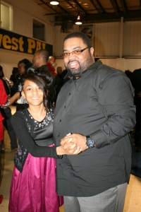 A young lady from Southwest PAL dancing with her father