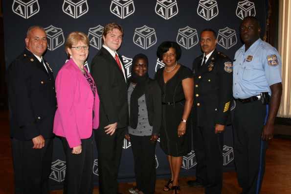 Scholarship recipients with PAL Commanding Officer Lt. Bill Eddis, Maureen Rush, Deputy Commissioner Ross and guests.
