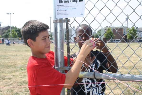 "Two young men worked together to create a ""String Fling"" art installation"