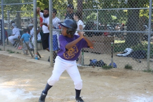 Ford PAL youngster focusing at the plate
