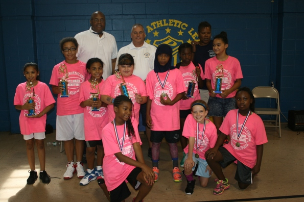 The Pink Team from Girls Basketball Camp received awards from PAL Commanding Officer Lt. Eddis, Sgt. Morris and Sgt. Ervin
