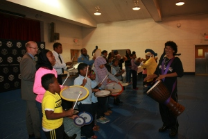 North Penn PAL kids, community members, and PAL representatives drum with ArtWell