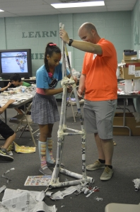 Oxford Circle PAL member, Anayah built a tower with Mr. Adam