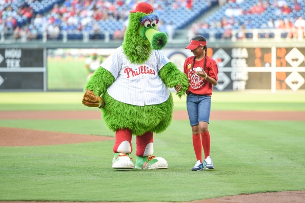 PAL kid Anayah, who threw out the evening's first pitch, was escorted to the mound by the Phanatic.